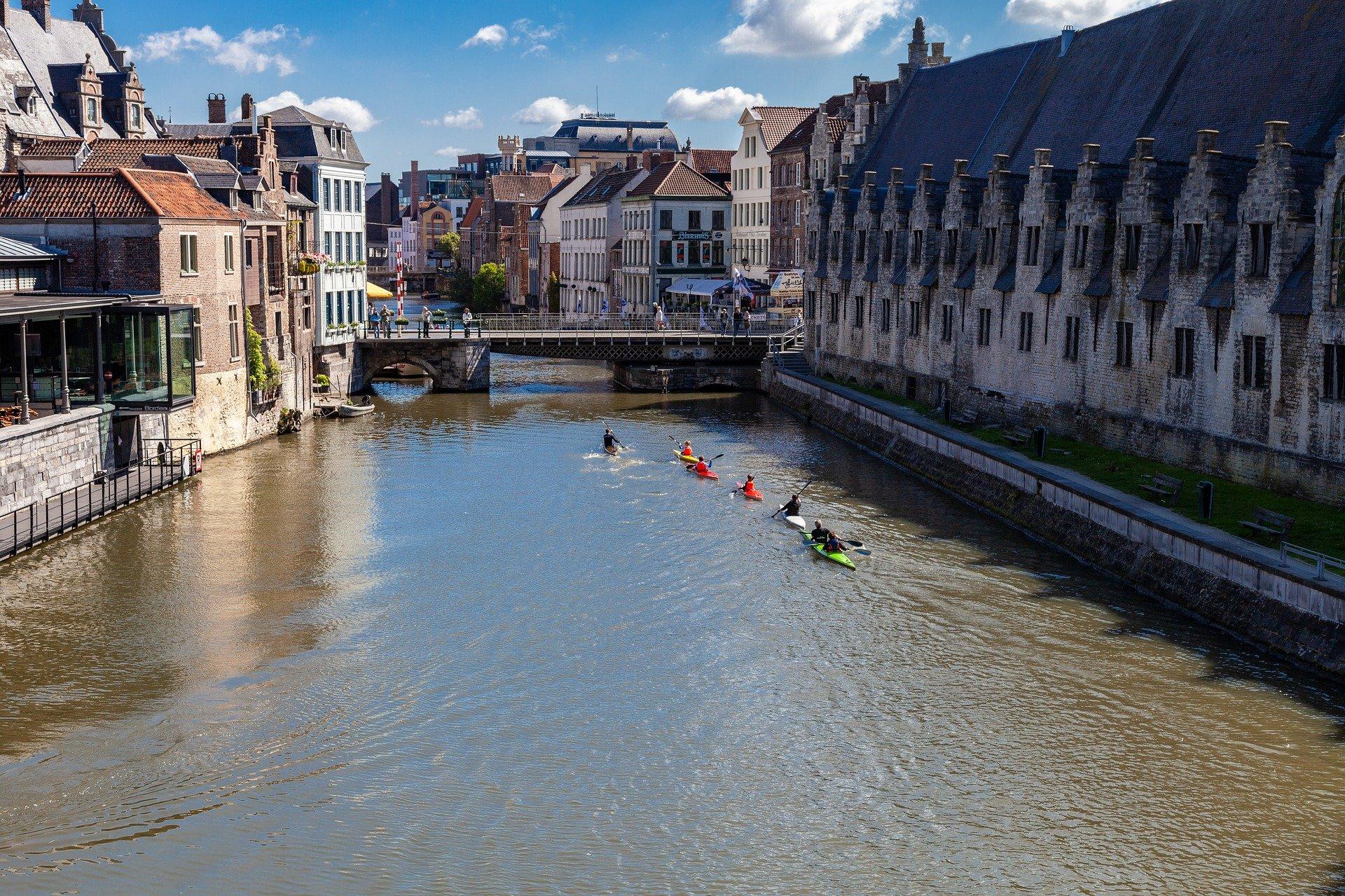 People are kayaking in the waterways of Belgium.