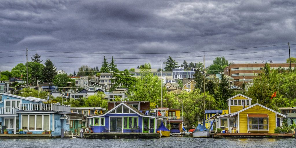 Colorful houseboats line the edges of Lake Union in Seattle, Washington. Lake Union is a fantastic place to go canoeing or kayaking in Seattle.