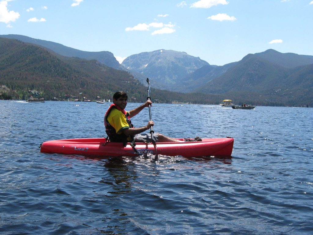 Grassy hills and mountains make up the horizon of kayaking in Denver's Rocky Mountain  National Park