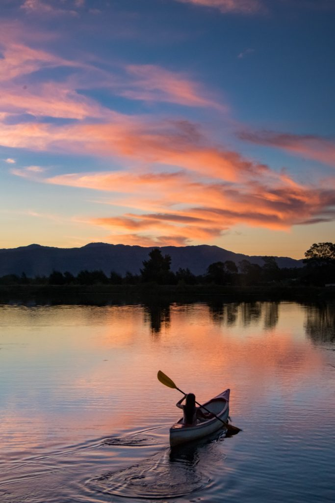 Cotton-candy sunsets set behind mountains and lakes making Denver a premier kayaking destination.