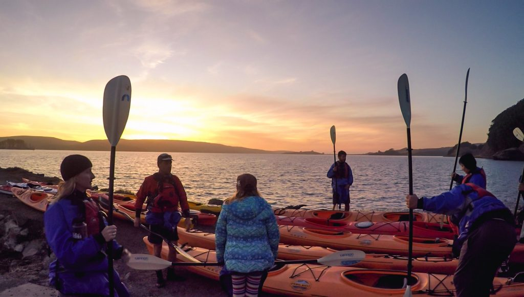 kayakers prepare to head out onto the calm waters Tomales  Bay to kayak around san Francisco's beautiful  landscape.