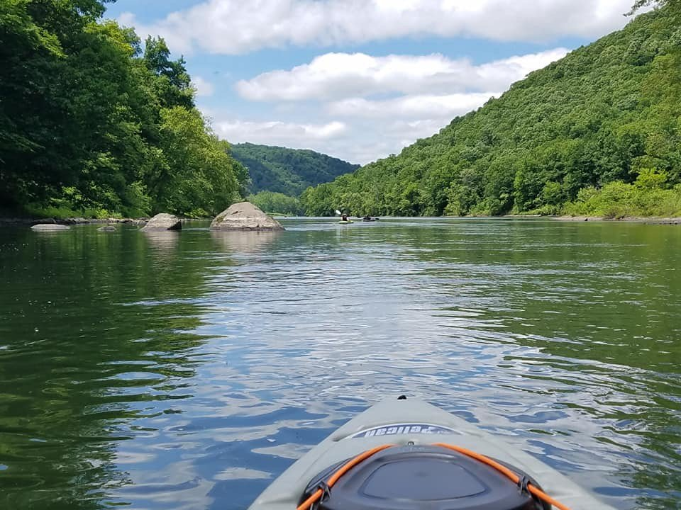 A kayak floats down one of the many rivers in  PA- kayaking in Philadelphia is always a beautiful and exciting outdoor activity!
