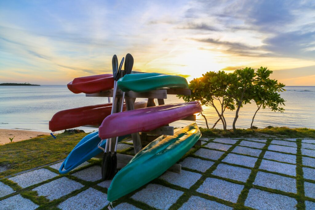A stack of canoes rests on the shore of a beach in Florida. Kayaking in Miami is both a relaxing yet thrilling way to explore the outdoors.