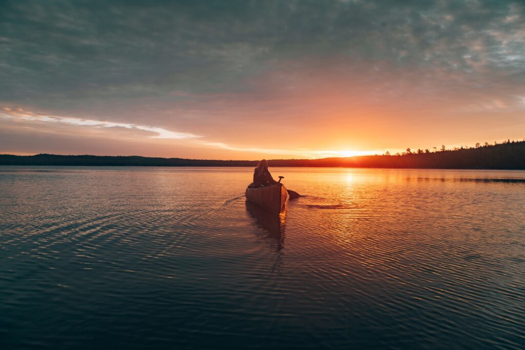 catch the early morning sunrise for a paddle experience you will never forget- the views are almost as inspiring as these canoe and kayaking quotes!