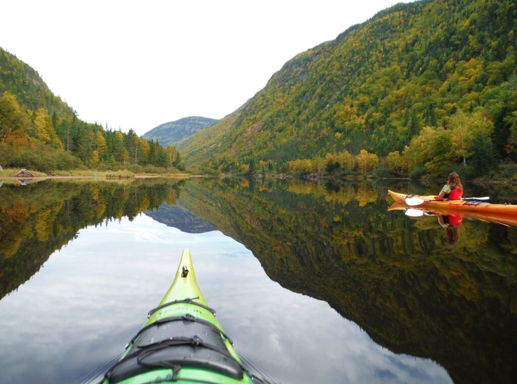 Kayaking in Charlotte has stunning mountain views with lush forests all around.