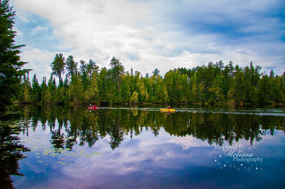 a beautiful lake reflection of kayaking in Minneapolis,