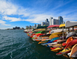 a bunch of kayaks are ready for paddlers to come explore the twin cities.