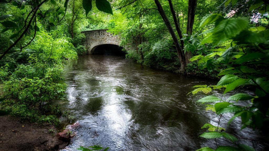 a stone bridge overlooks Minnehaha Creek in Minneapolis