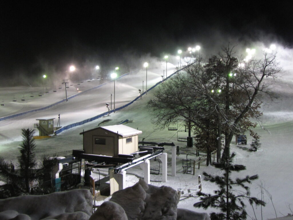 Buck Hill's ski slopes are illuminated during a night skiing session. Buck Hill is one of the closest ski resorts near Minneapolis.