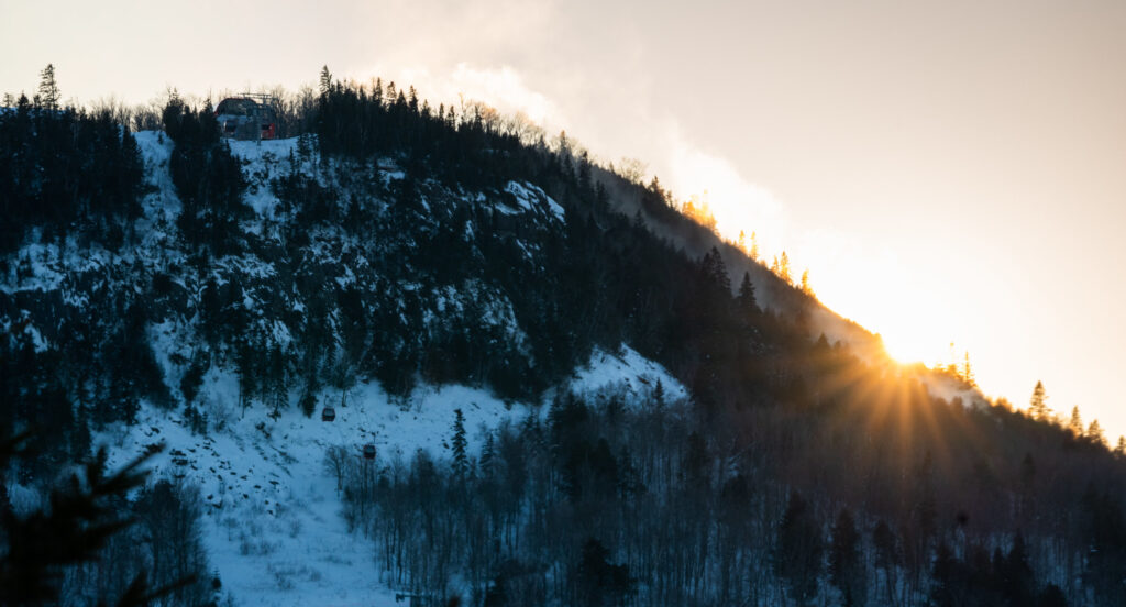The sun rises over Lutsen Mountains Ski Resort in the winter. This is one of the largest and most beloved ski resorts near Minneapolis.