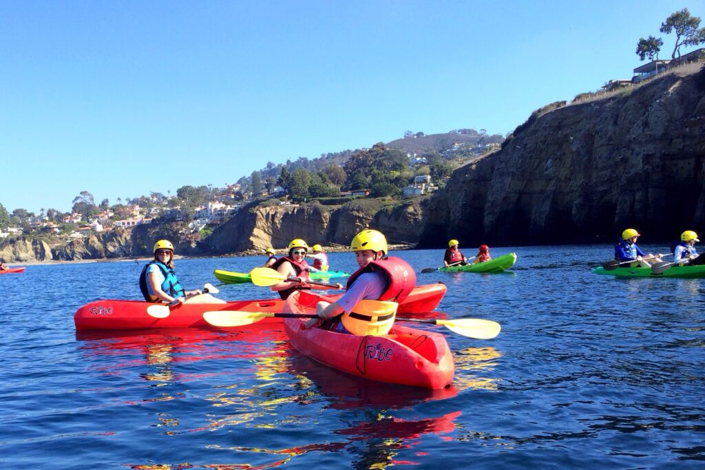 rocky cliffs and blue waters of la jolla shores make it a great place for kayaking in san diego