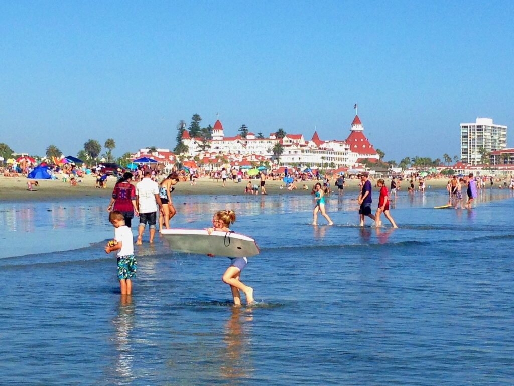 kids play at coronado beach which is a great place to go kayaking in san diego