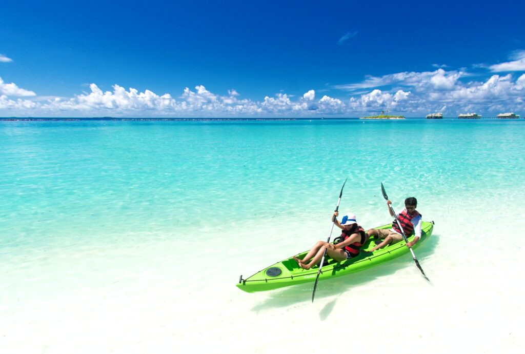 white sand beaches and blue waters where kayakers are paddling in Tampa
