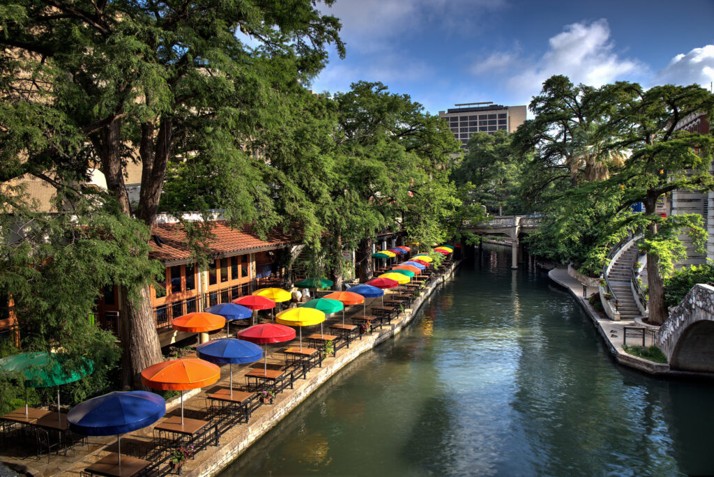 kayaks line the riverwalk in San Antonio, a wonderful place to go canoeing and kayaking in Texas