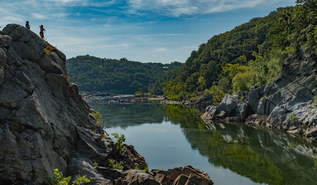 Cliff overlooking the Potomac River with 2 people standing on top - hiking near Washington DC