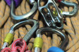 Essential Rock Climbing Gear: An assortment of HMS pear shaped carabiners with slings a belay plate and prusik cord