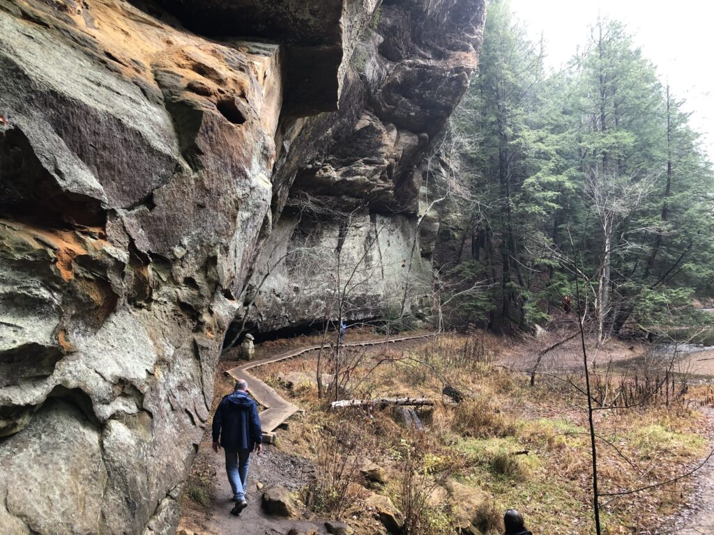 You can see lots of large rock formations while hiking in Ohio, like this one in Hocking Hills State Park.