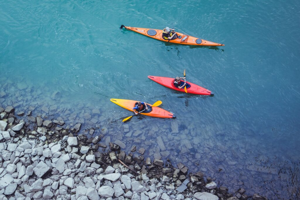 kayakers go paddling in the deep blue shoes