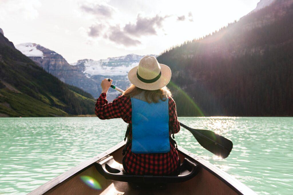 kayaker paddling through mountains